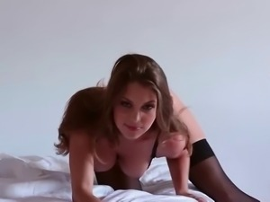 Brunette sex goddess in stockings working her hot cunt