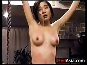 This amateur Japanese girl gets suspended and flogged