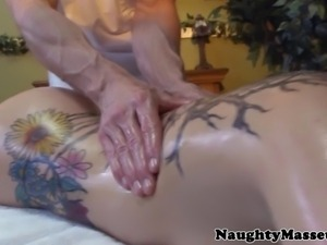 Real masseur is fingering hairy brunette pussy