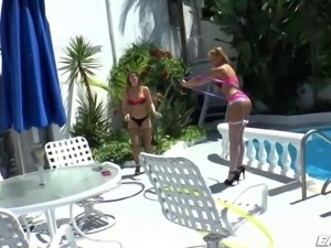 Beautiful Athletic babes Carmen and Jennas is playing hula hoops outdoors...