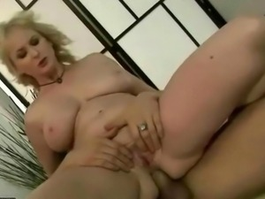 Busty grandma enjoys anal sex with her young boyfriend