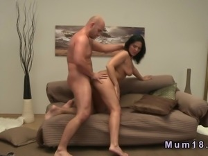 Tanned brunette mature lady with stunning body gives blowjob to her man on...