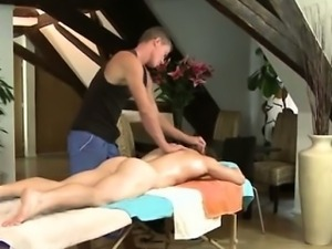 Massage for muscled naked man at gay spa