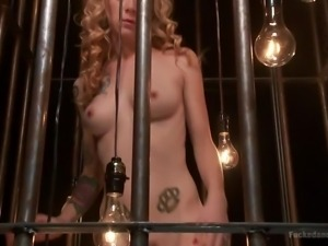 beautiful little blonde caged and fed with cock