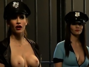 Two hot blonde and black haired babes pounding in the jail