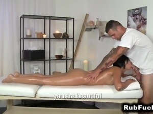 Oiled tanned brunette fucking on massage table