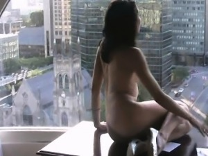 Tiny Canadian rubbing oily in window