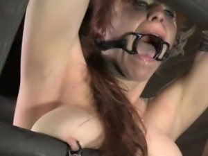 Gagged sub gets her pussylips stretched