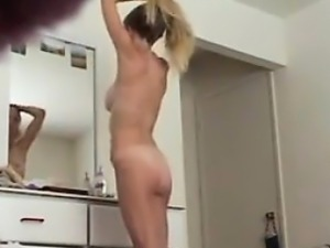 Spying On Wife As She Looks In A Mirror