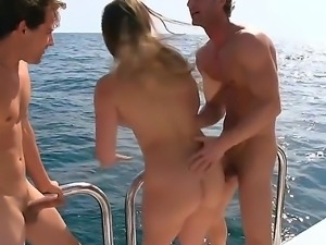 Threesome sex in the sea with juicy chick Dani Daniels