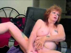 Nasty blonde mature strips of clothes and shows pussy