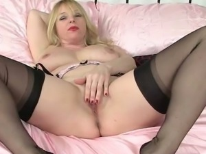 British mom gives your eyes and her pussy a treat.