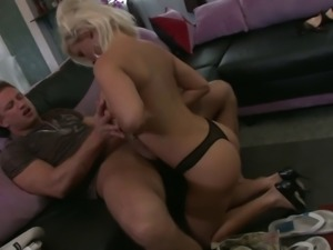 Lucky stud gets to bang hot MILF Diamond Foxxx on the sofa