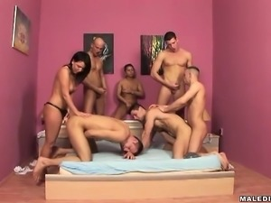 Hot young brunette bends over to get banged in this wild orgy