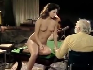 Bearded old man gets his cock polished by pretty young brunette