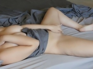 girl masturbating on the bed