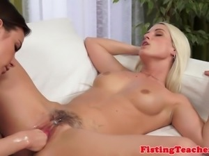 Pierced lesbian pussy fisted gently