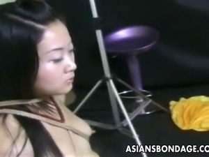 Amateur Asian teen is roped up by her master real tight