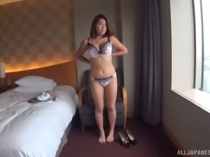 Brunette from Japan pleases her fans by slowly going full-naked