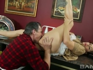 Buxom raven haired mistress Raylene lies on table and gets her kitty nailed...