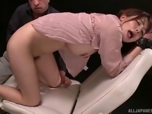 Massaging her pussy and filling her ass with a toy makes her pleased