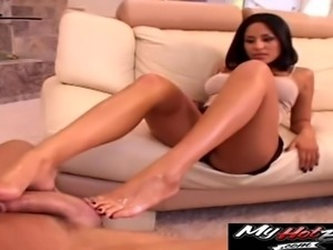 Jenaveve Jolie uses her formidable feet to make her man's dick sitff