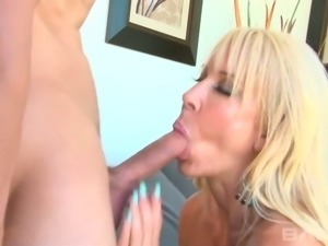 Big breasted mature blondie Erica Lauren got her kitty polished in mish style...