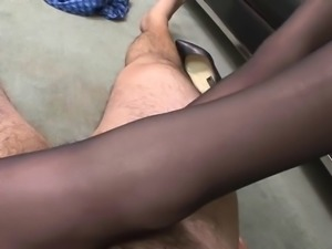 Amazing blonde gives pantyhose footjob