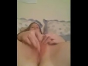 selfshot teen strips ahead fingers pussy in bedroom