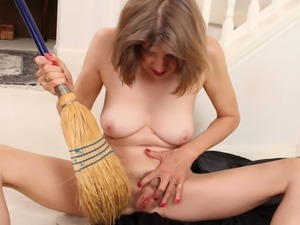 Hairy grandma masturbating with a broom
