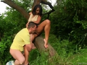 Fucking a tanned babe's shaved pussy and pissing on her outdoors