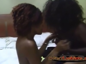 Busty ebony girlfriend licking cunts in bedroom
