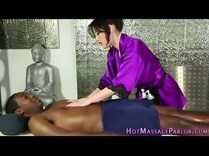 Masseuse jerks black cock