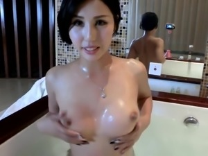 Chinese lady takes a bath & records herself