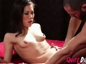 Kalina Ryu grips the bed while getting pounded from behind